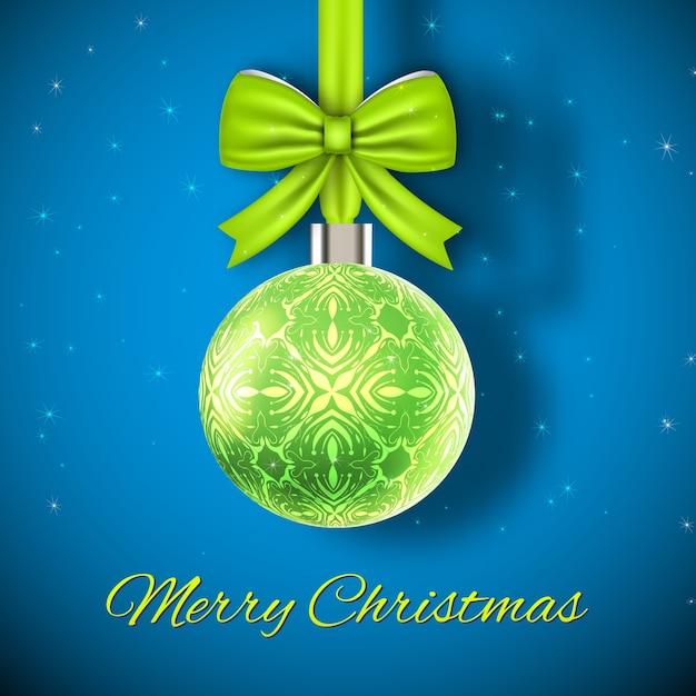 Christmas card glowing green christmas ball on blue Free Vector