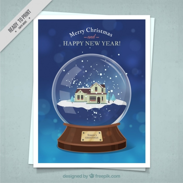 Christmas card of snowball with a nice house