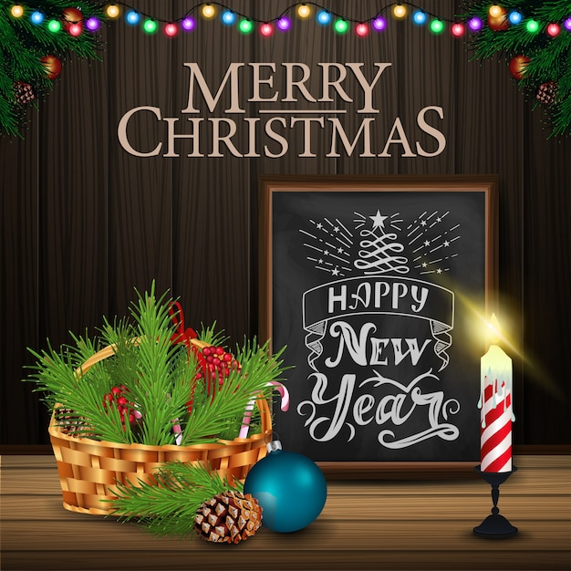 Christmas card with chalkboard and candle on wood background Premium Vector