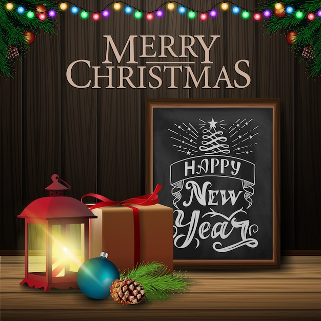 Christmas card with chalkboard and old lantern on wood background Premium Vector