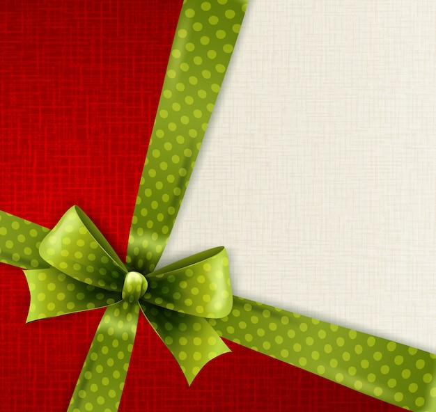 Christmas card with green polka dots bow Premium Vector