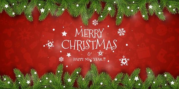 Рождественский состав. праздничные пожелания на красном фоне с еловыми ветками. для приветствия Premium векторы