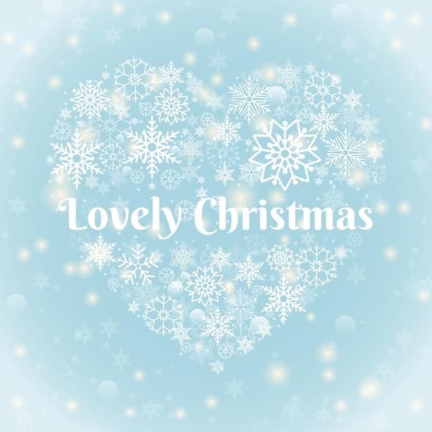 크리스마스 컨셉-스파크와 하늘색 배경에 심장 모양 눈송이에 사랑스러운 크리스마스 텍스트. 무료 벡터