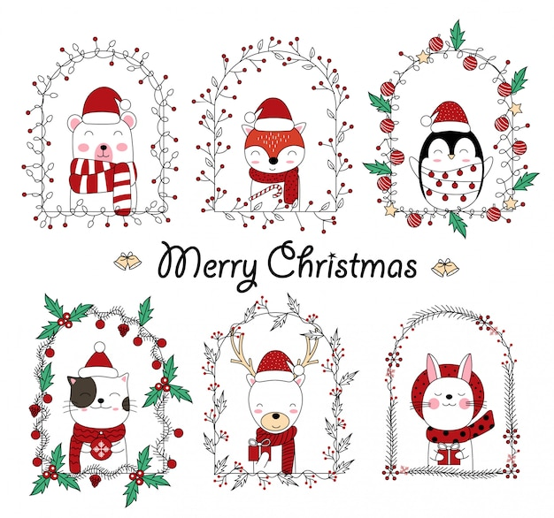 Christmas cute animal cartoon in floral frame Premium Vector