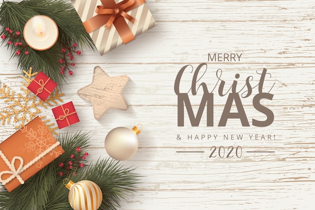 Christmas decoration in wooden background Free Vector