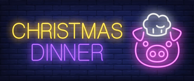 Christmas dinner neon text with pig in cap Free Vector