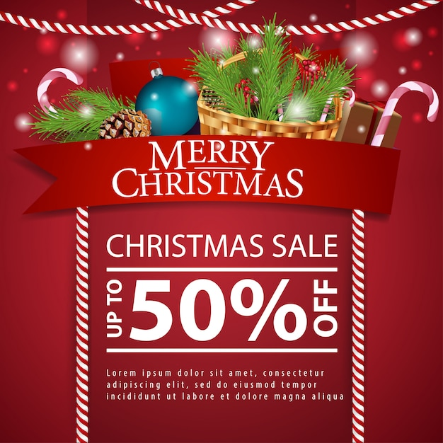 Christmas discount card with red ribbon and basket with christmas tree branch Premium Vector