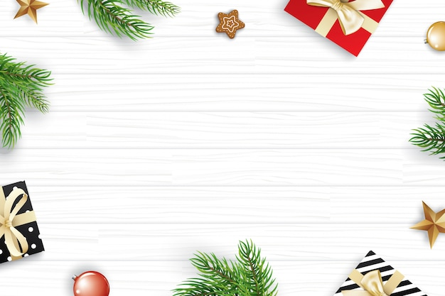Christmas frame with copy space for text on white wooden background. Premium Vector