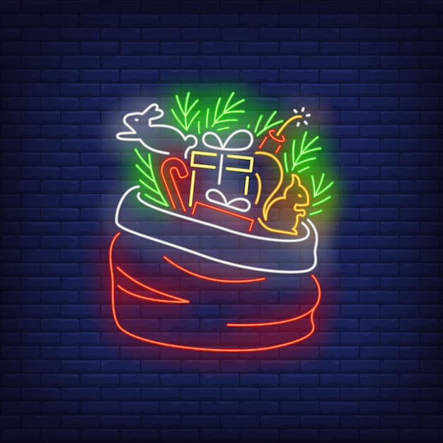Christmas gifts in sack in neon style Free Vector