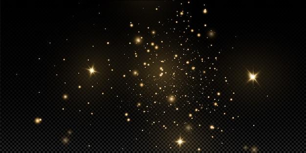 クリスマスの黄金のほこり、黄色の火花、黄金の星が特別な光で輝きます。きらめく魔法の塵の粒子で輝きます。 Premiumベクター
