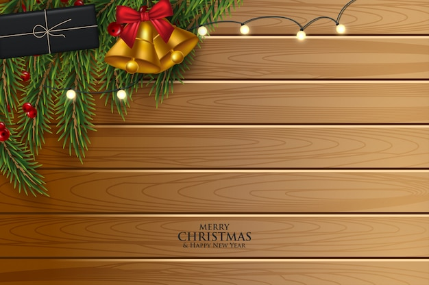 Christmas greeting card with fir branches decorated with ribbons, red and gold balls and berries. Premium Vector