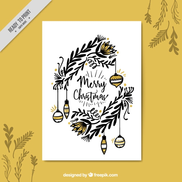 Christmas greeting with hand drawn leaves and ornaments Free Vector