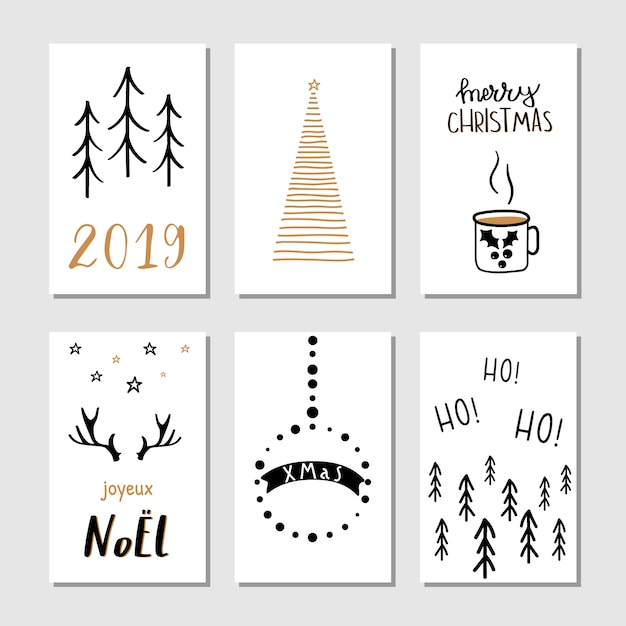 Christmas hand drawn greeting cards. Premium Vector