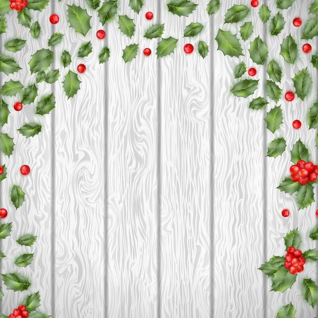 木製の背景にクリスマスのヒイラギ。そしてまた含まれています Premiumベクター