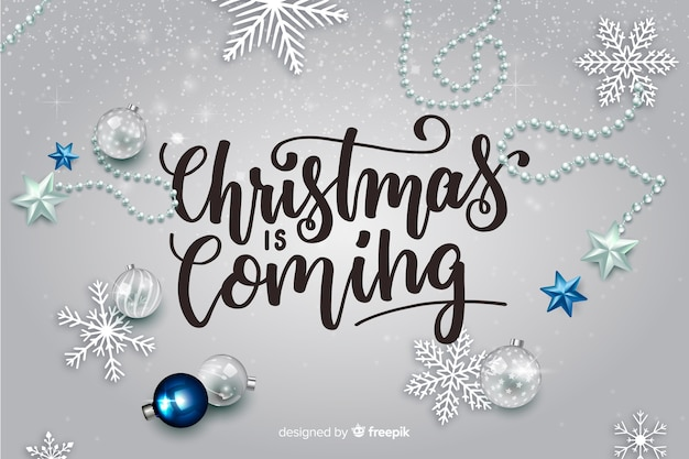 Christmas lettering with realistic elements Free Vector