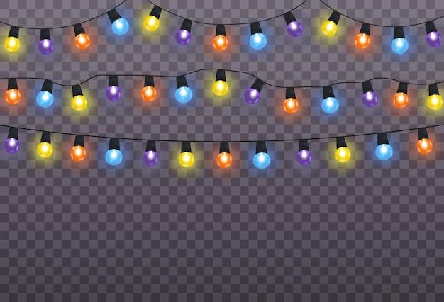 투명 한 배경에 고립 된 크리스마스 조명입니다. 크리스마스 빛나는 갈 랜드. 프리미엄 벡터