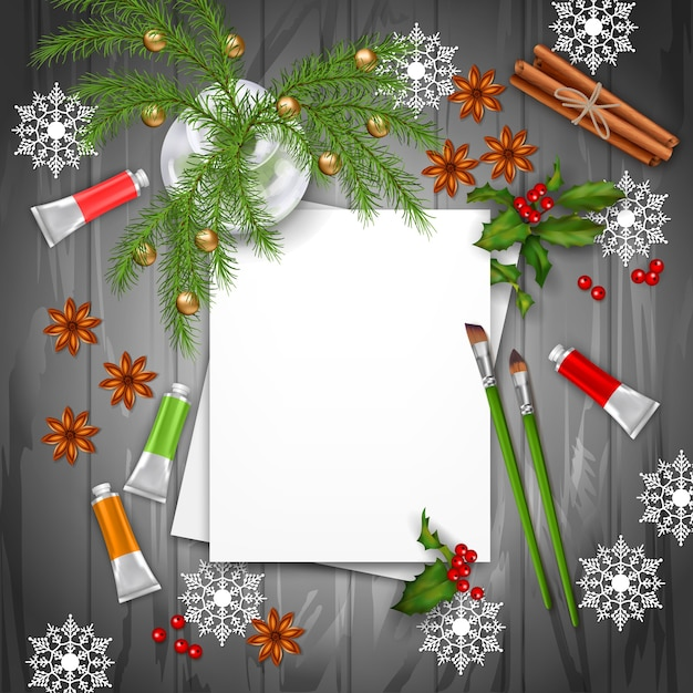 Christmas and new year background with blank sheets of paper, fir twigs, paints and brushes Premium Vector