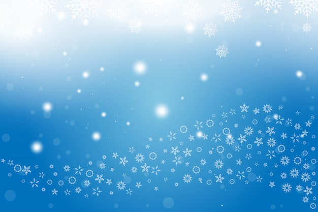 Christmas and new year background with snowflakes and light effects on a blue background. Premium Vector