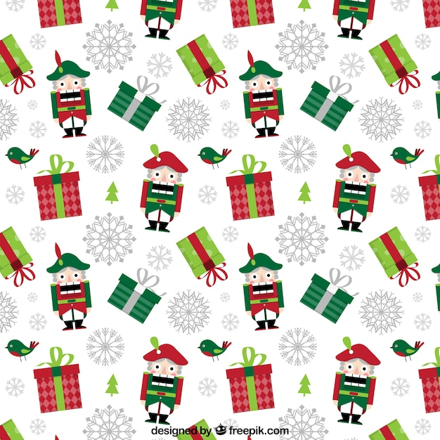 Christmas pattern with gifts and nutcrackers Free Vector
