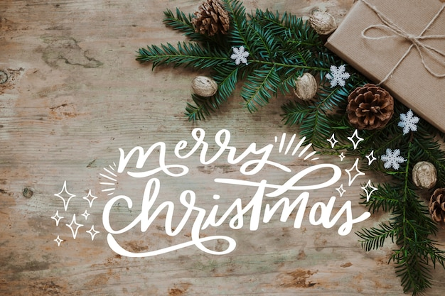 Christmas photo with lettering and branches Free Vector