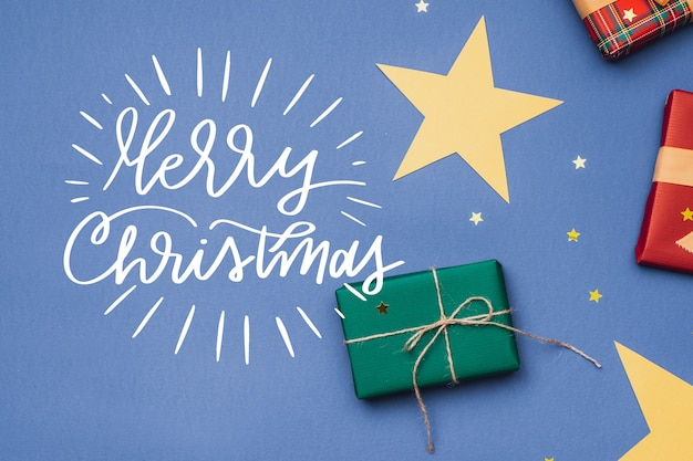 Christmas photo with presents and lettering Free Vector