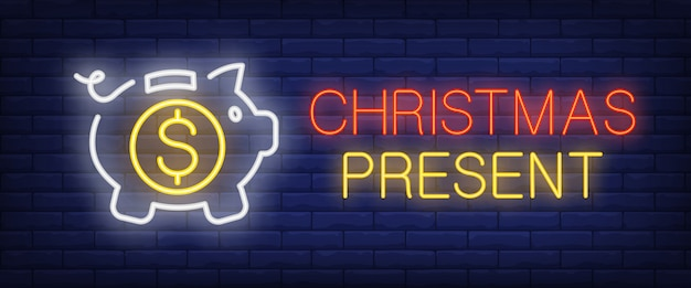 Christmas present neon text with piggy bank and coin Free Vector