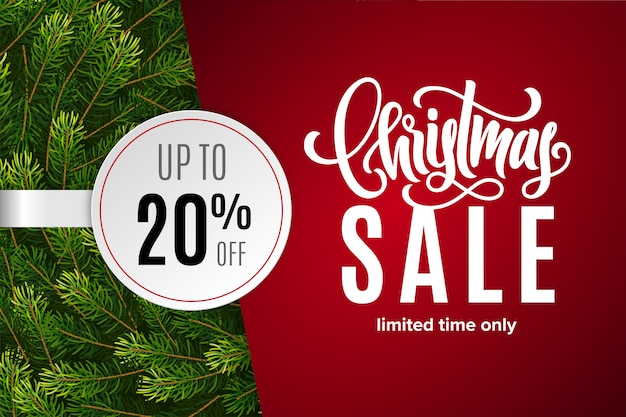 Christmas sale 20% off with paper sticker with fir tree branches Premium Vector