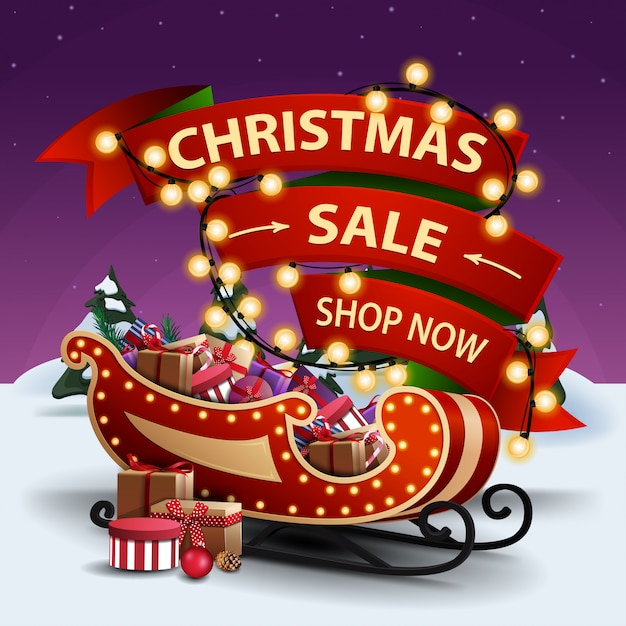 Christmas sale, shop now, discount banner with red ribbon wrapped in garland Premium Vector