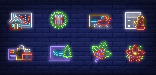 Christmas sale symbols set in neon style Free Vector