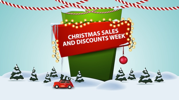 Christmas sales and discount week, cartoon discount banner with winter landscape with red vintage car carrying christmas tree Premium Vector
