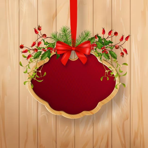 ホリデーガーランドと木製フレームのクリスマス看板 Premiumベクター