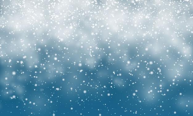 クリスマスの雪。青い背景に落ちる雪片。降雪。 Premiumベクター