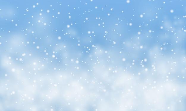 クリスマスの雪。水色の背景に降る雪。降雪。 Premiumベクター