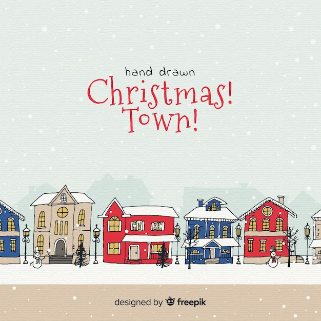 Christmas town in hand drawn design Free Vector