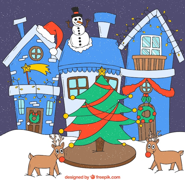 Christmas tree, reindeers, snowman and houses decorated for christmas