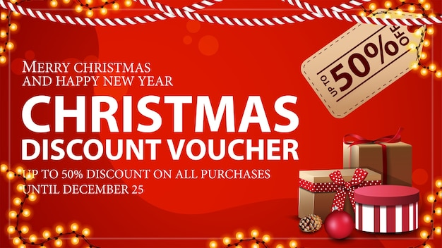 Christmas voucher with large price tag, gifts and garland frame. discount voucher, up to 50 off on all purchases. Premium Vector