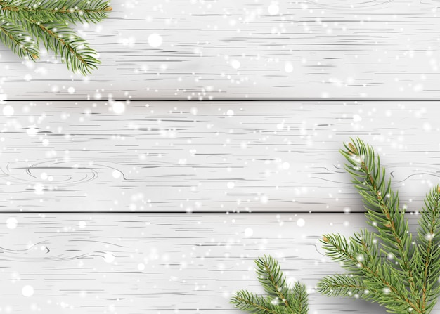 Christmas white wooden background with holiday fir tree branches, pine cone and falling shiny snow. flat lay, top view with copy space for your text. Premium Vector
