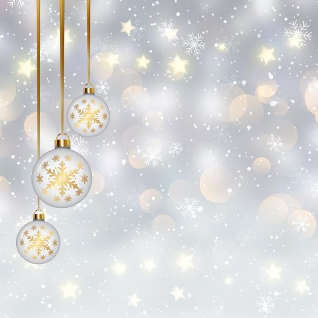 Natale con palline appese su un design di luci bokeh Vettore gratuito