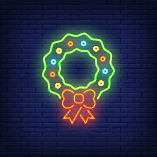Christmas wreath neon sign element. christmas concept for night bright advertisement Free Vector