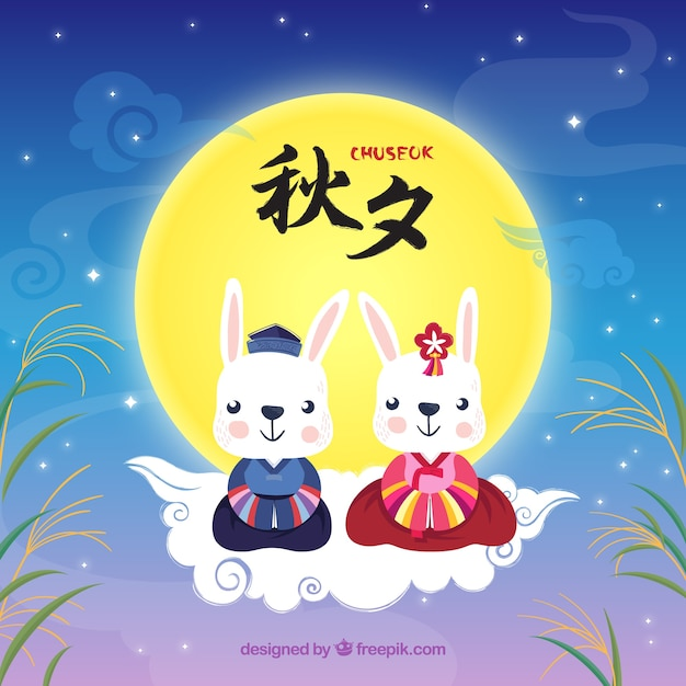Chuseok background with cute rabbits Free Vector