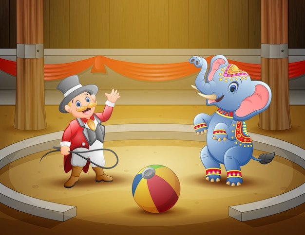 Circus ringmaster performs a trick along with elephant in arena Premium Vector