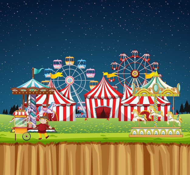 Circus scene with many rides at night time Free Vector