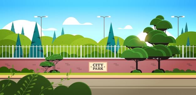 City park sign board on fence beautiful summer day sunrise landscape background horizontal Premium Vector