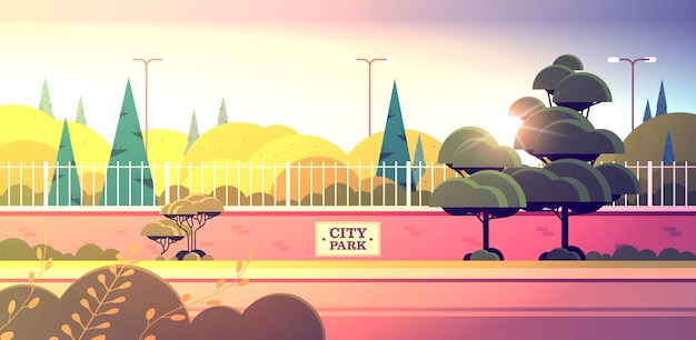 City park sign board on fence beautiful summer day sunset landscape background horizontal Premium Vector