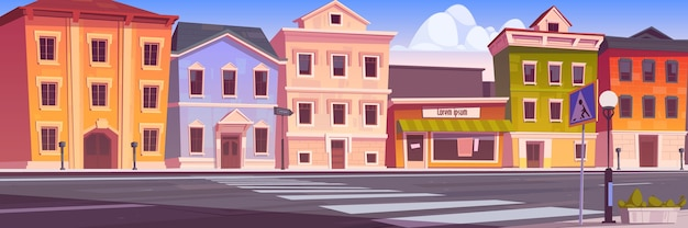 City street with houses, empty car road and pedestrian crosswalk Free Vector