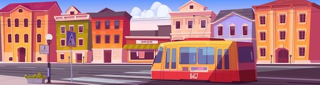 家、路面電車、横断歩道のある空の車道がある街の通り。路面電車のある漫画の街並み、住宅、店舗、道路上の鉄道のある都市景観 無料ベクター