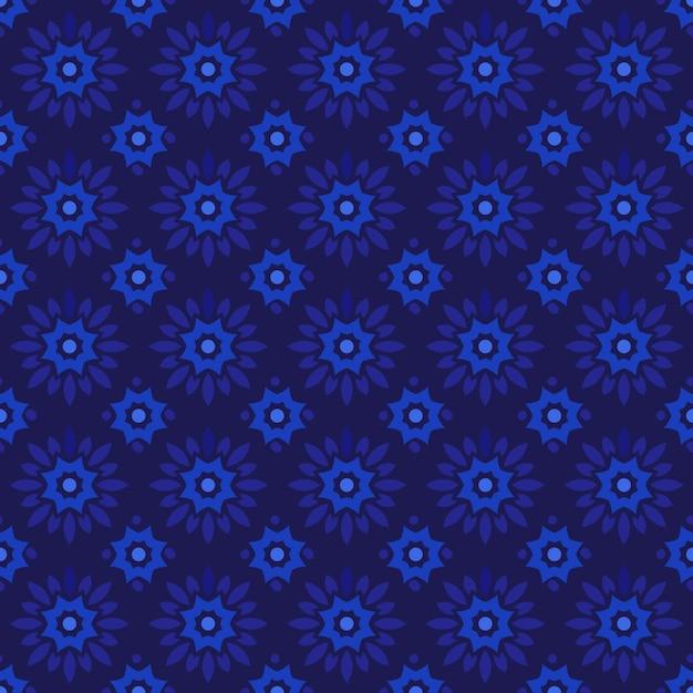 古典的なバティックのシームレスなパターン背景。豪華な幾何学的なマンダラの壁紙。ダークブルーのエレガントなトラディショナルフローラルモチーフ Premiumベクター