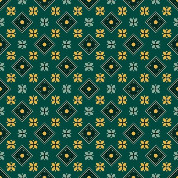 古典的なバティックのシームレスなパターン背景。豪華な幾何学的なマンダラの壁紙。緑の色でエレガントな伝統的な花のモチーフ Premiumベクター