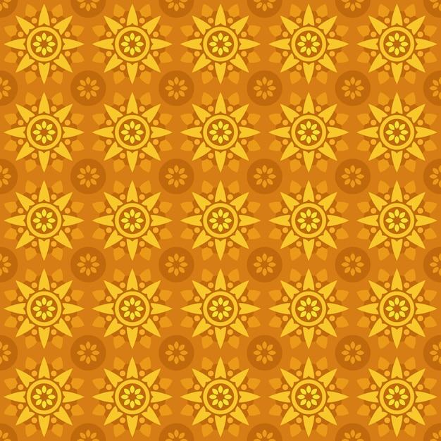 古典的なバティックのシームレスなパターン背景。豪華な幾何学的なマンダラの壁紙。オレンジイエローカラーのエレガントな伝統的なフローラルモチーフ Premiumベクター