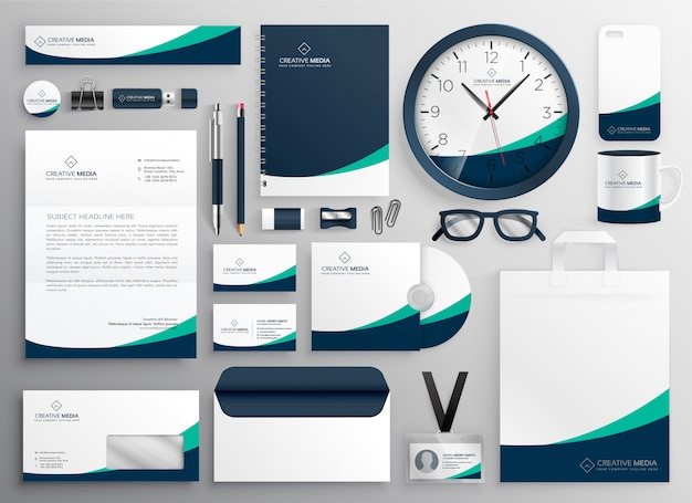 Clean business stationery for your brand Free Vector
